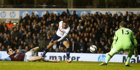 Nacer Chadli (C) of Tottenham Hotspur has his shot saved by Adrian of West Ham United during their English League Cup quarter-final soccer match at White Hart Lane, London, December 18, 2013. REUTERS/Andrew Winning