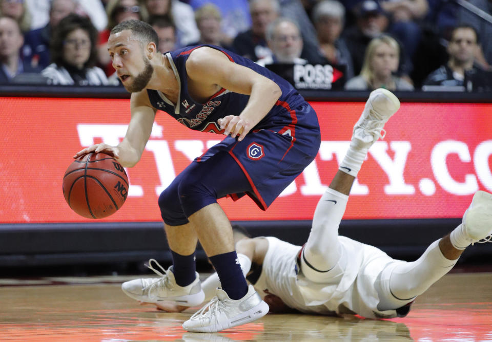 """FILE - In this March 12, 2019, file photo, St. Mary's Jordan Ford dribbles around a Gonzaga player during the second half of an NCAA college basketball game in the championship pf the West Coast Conference tournament in Las Vegas. Saint Mary's certainly wasn't supposed to beat No. 1 Gonzaga last week to steal away the West Coast Conference tournament title and automatic NCAA bid. """"We know that we can beat anybody,"""" leading scorer Jordan Ford said. """"Since we beat the No. 1 team in the country, and to be able to see and play against the No. 1 team in the country three times this year, we know that we can hang with anybody."""" (AP Photo/John Locher, File)"""