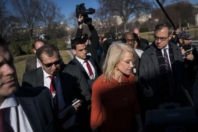 <p>Kellyanne Conway, counselor to President Trump, is surrounded by members of the media as she talks about a possible government shutdown in front of the West Wing at the White House in Washington on Friday, Jan. 19, 2018. (Photo: Jabin Botsford/The Washington Post via Getty Images) </p>