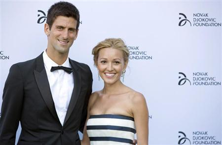 Serbian tennis player Novak Djokovic and his girlfriend Jelena Ristic pose for photographers as they arrive at a fundraising dinner for the Novak Djokovic Foundation in London