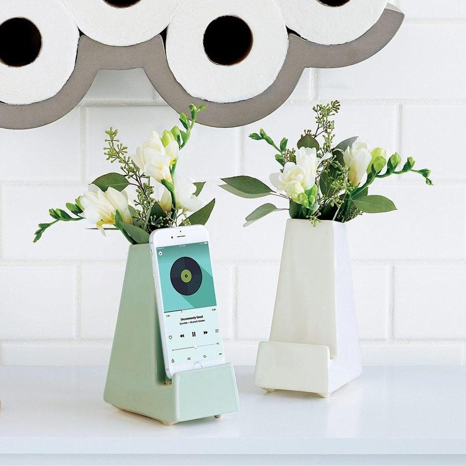 """<p>This <a href=""""https://www.popsugar.com/buy/Bedside-Smartphone-Vase-134410?p_name=Bedside%20Smartphone%20Vase&retailer=uncommongoods.com&pid=134410&price=32&evar1=geek%3Aus&evar9=36141091&evar98=https%3A%2F%2Fwww.popsugar.com%2Fnews%2Fphoto-gallery%2F36141091%2Fimage%2F44337016%2FBedside-Smartphone-Vase&list1=gadgets%2Choliday%2Cgeek%20gear%2Cgift%20guide%2Cfriendship%2Cproducts%20under%20%24100%2Cbudget%20tips%2Choliday%20living%2Ctech%20gifts%2Choliday%20tech%2Cgifts%20for%20women%2Cgifts%20under%20%24100%2Cgifts%20under%20%2450%2Cgifts%20under%20%2475%2Cunder%20%24100&prop13=api&pdata=1"""" class=""""link rapid-noclick-resp"""" rel=""""nofollow noopener"""" target=""""_blank"""" data-ylk=""""slk:Bedside Smartphone Vase"""">Bedside Smartphone Vase</a> ($32) is a pretty multitasking gift.</p>"""
