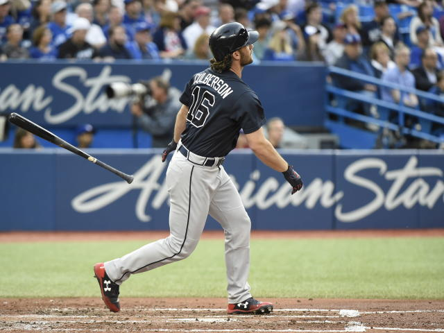 Atlanta Braves' Charlie Culberson watches his home run against the Toronto Blue Jays during the fourth inning of a baseball game Tuesday, June 19, 2018, in Toronto. (Nathan Denette/The Canadian Press via AP)