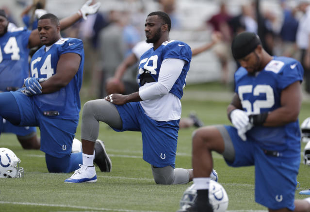 In this Friday, July 27, 2018 photo, Indianapolis Colts linebacker Tarell Basham (58) stretches during practice at the NFL team's football training camp in Westfield, Ind. (AP Photo/Michael Conroy)