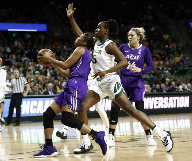 Abilene Christian guard Dominique Golightly, left, drives to the basket as Baylor center Queen Egbo, center, defends in the first half of a first-round game in the NCAA women's college basketball tournament in Waco, Texas, Saturday March 23, 2019. (AP Photo/Tony Gutierrez)