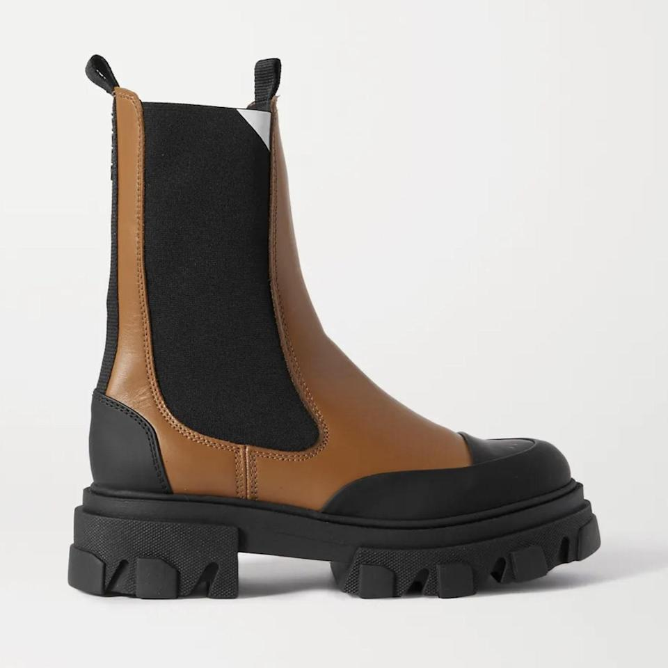 """Ganni managed to squeeze some of its signature western charm in with these rubber-soled Chelsea boots, and they'll look good paired with a <a href=""""https://www.glamour.com/gallery/floral-print-outfits-for-fall?mbid=synd_yahoo_rss"""" rel=""""nofollow noopener"""" target=""""_blank"""" data-ylk=""""slk:flowy boho dress"""" class=""""link rapid-noclick-resp"""">flowy boho dress</a> come spring. $485, Net-a-Porter. <a href=""""https://www.net-a-porter.com/en-us/shop/product/ganni/rubber-trimmed-leather-chelsea-boots/1294403"""" rel=""""nofollow noopener"""" target=""""_blank"""" data-ylk=""""slk:Get it now!"""" class=""""link rapid-noclick-resp"""">Get it now!</a>"""