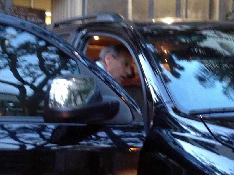 San Diego Mayor Bob Filner enters a black SUV parked near City Hall after loading boxes in the backseat in this photo tweeted by city employee Diana Palacios, Wednesday night, Aug. 21, 2013. A tentative deal has been reached involving the sexual harassment lawsuit against the Democrat, but it's unclear whether the agreement includes his resignation, something demanded by a chorus of fellow Democrats and a long line of women who say Filner mistreated them. (AP Photo/Diana Palacios)