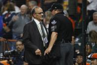 Joe Torre talks to home plate umpire Sam Holbrook after the seventh inning of Game 6 of the baseball World Series between the Houston Astros and the Washington Nationals Tuesday, Oct. 29, 2019, in Houston. (AP Photo/Matt Slocum)