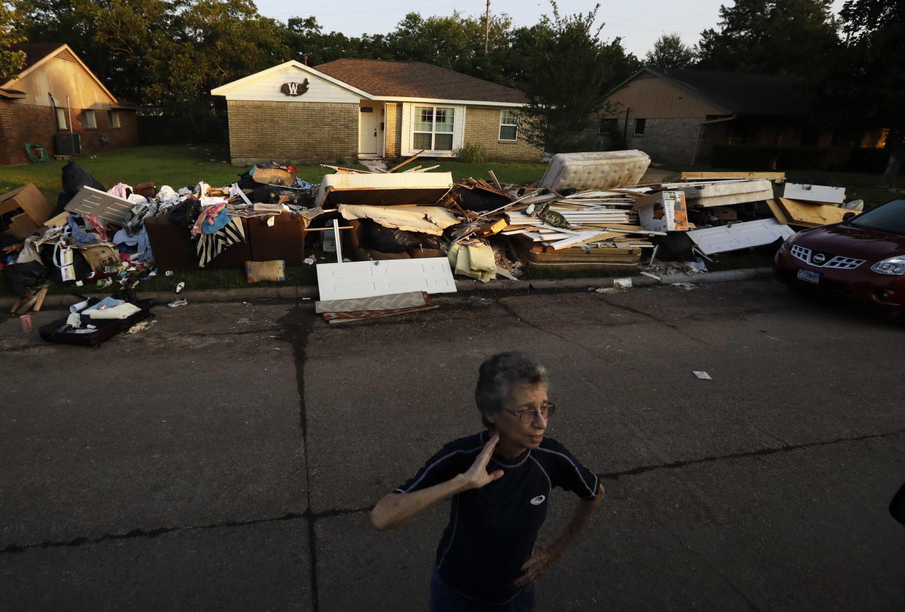 <p>Joan Finmore looks out as she takes a break from sorting items at a friend's flooded home Saturday, Sept. 2, 2017, in Houston, Texas. (Photo: Gregory Bull/AP) </p>