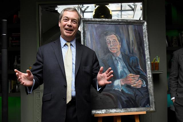 Nigel Farage during the unveiling of his 'Mr Brexit' portrait by artist Dan Llywelyn Hall at L'Escargot Restaurant in London (PA)