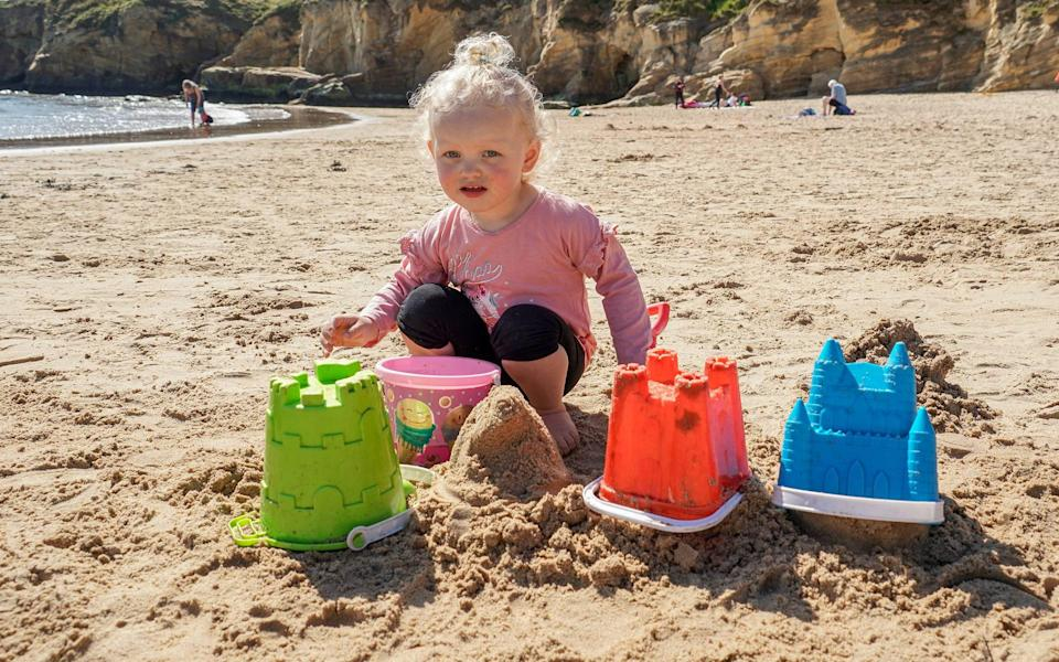 Marnie Jane Olsen, two, builds at sandcastle at Cullercoats Bay - Will Walker / North News