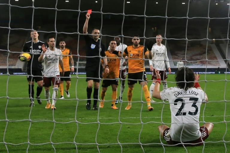 Down and off: David Luiz's (bottom, right) sending off changed the game as Arsenal lost 2-1 to Wolves