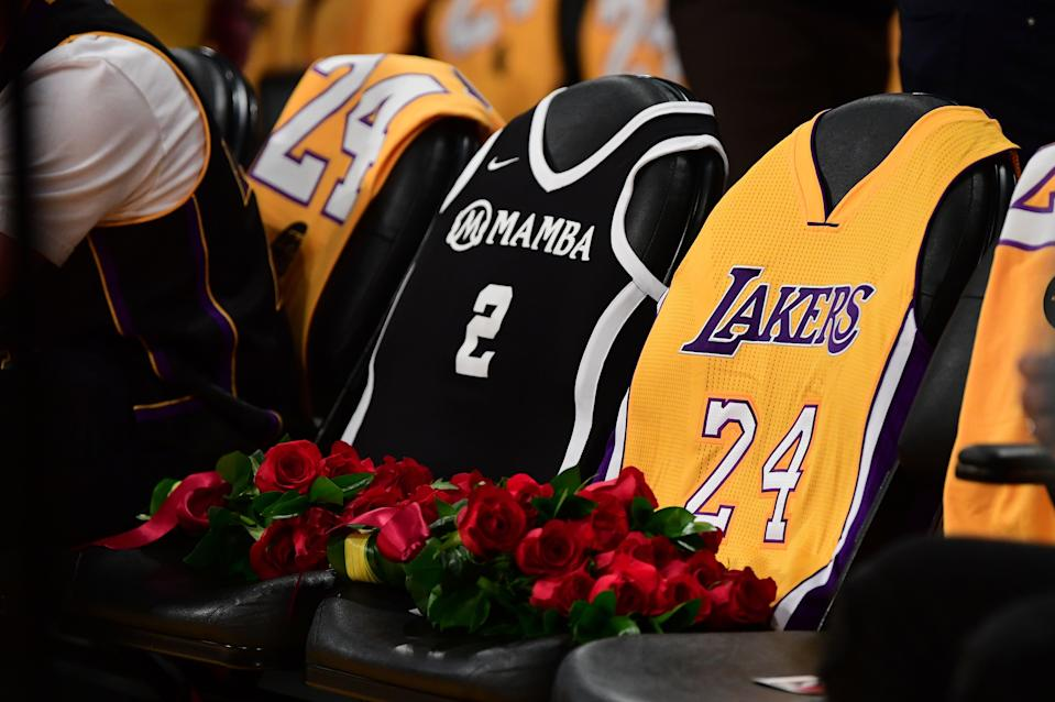 When the Lakers returned to the court for the first game following the death of Kobe Bryant, his daughter, Gianna, and seven others, the organization paid tribute to the Bryants by placing their jerseys on the courtside seats they once occupied on the Staples Center sidelines. (Photo by Frederic J. Brown/AFP via Getty Images)