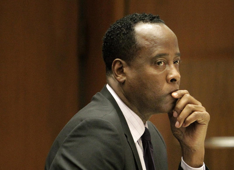 "FILE - In this Friday, Oct. 21, 2011, file photo, Michael Jackson's former doctor Conrad Murray sits in a courtroom during his involuntary manslaughter trial in Los Angeles. Jurors hearing a civil case on Wednesday May 1,2013 against Jackson's concert promoter that Murray was more than $500,000 in debt and his finances were ""severely distressed."" (AP Photo/Reed Saxon, Pool, File)"