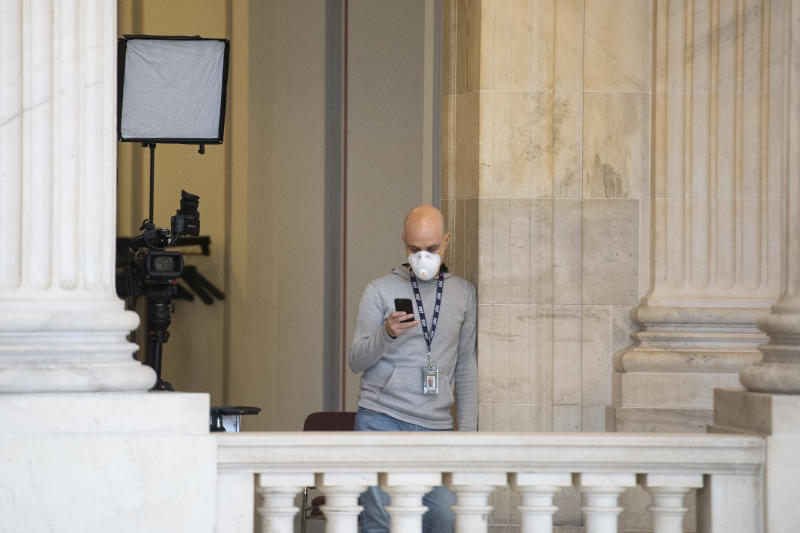 UNITED STATES - MARCH 23: A broadcast news cameraman wears a mask in the Russell Rotunda on Monday, March 23, 2020. (Photo by Caroline Brehman/CQ-Roll Call, Inc via Getty Images)
