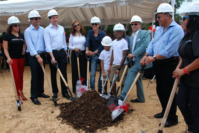 In this image released by the Maestro Cares Foundation, singer Marc Anthony, fifth from left, poses for photos with members of his foundation and local authorities during the groundbreaking ceremony of new facilities for the Children of Christ orphanage in the eastern city of La Romana, Dominican Republic, Friday, Nov. 23, 2012. The foundation, run by Anthony with music and sports producer Henry Cardenas, plans to build a new residence hall, classrooms and a baseball field for the orphanage founded in 1996 for children who were abused or abandoned or whose parents were unable to care for them. (AP Photo/Maestro Cares Foundation)