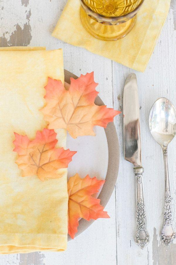 "<p>Tie dye your napkins for a more contemporary bohemian Thanksgiving table. Your guests will never believe that these napkins were dyed using turmeric and basil. This way you'll be using fall/Thanksgiving colors but in an unexpected way.</p><p>See more at <a href=""https://sugarandcharm.com/2014/09/naturally-dyed-linens-using-berries-and-herbs.html?section-15"" rel=""nofollow noopener"" target=""_blank"" data-ylk=""slk:Sugar and Charm"" class=""link rapid-noclick-resp"">Sugar and Charm</a>.</p>"