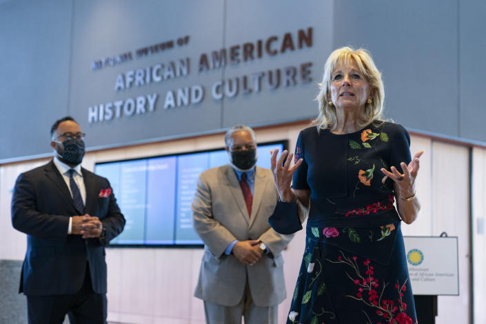 First lady Jill Biden speaks to gathered employees and media during a visit to the National Museum of African American History and Culture with Lonnie Bunch, Secretary of the Smithsonian, center, and National Museum of African American History and Culture director Kevin Young, left, Friday, May 14., 2021, in Washington. (Carolyn Kaster/AP)