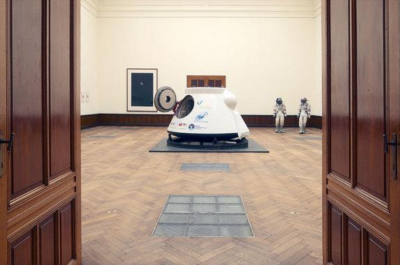A twice-flown Soviet-era VA space capsule and a pair of Russian spacesuits are displayed at a Belgian gallery prior to their sale by Lempertz auction house on May 7, 2014.