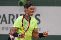 Spain's Rafael Nadal clenches his fist as he plays Serbia's Novak Djokovic rduring their semifinal match of the French Open tennis tournament at the Roland Garros stadium Friday, June 11, 2021 in Paris. (AP Photo/Michel Euler)