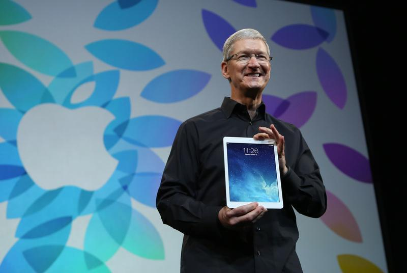 Apple Inc CEO Tim Cook holds up the new iPad Air during an Apple event in San Francisco