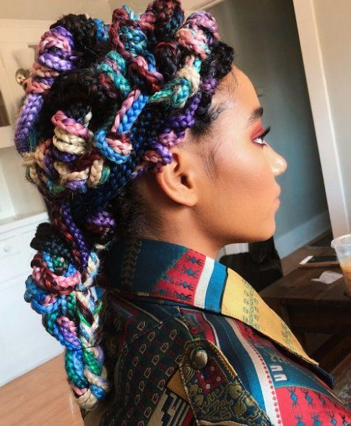 <p>Hitting us with the most magical rainbow braids ever, Amandla Stenberg turned to hairstylist and textured hair expert Vernon Francois for her epic multi-coloured Summer knotted box braids.</p>