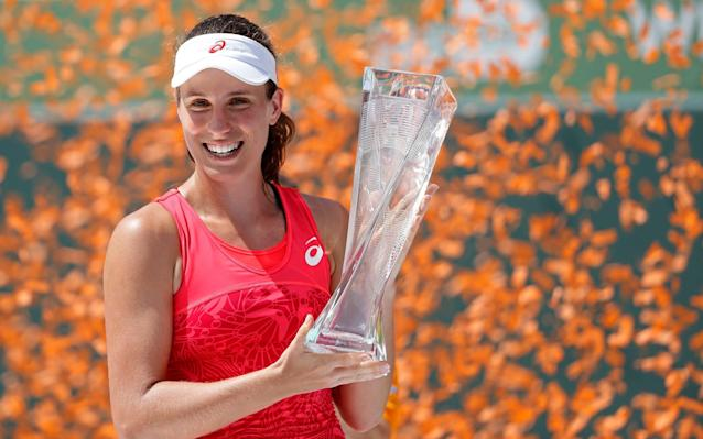 Johanna Konta celebrates with her trophy - USA Today Sports