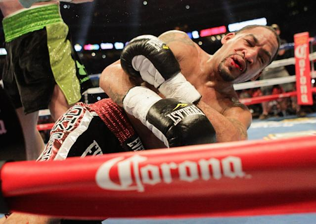 """James Kirkland lies on the mat after being knocked out by Saul """"Canelo"""" Alvarez during the third round during of a 154-pound boxing bout Saturday, May 9, 2015, in Houston. (AP Photo/Bob Levey)"""