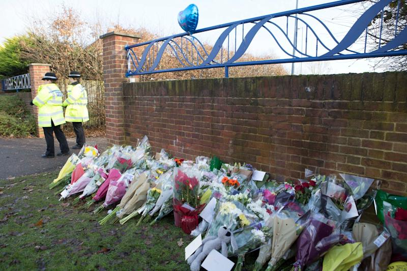Floral bouquets left in tribute to Harley at the entrance to Debden Park High School in Willingale Road (PA)