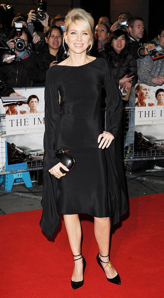 "Naomi Watts looked like she could have flapped her arms and flown away from the London premiere of ""The Impossible"" on Monday with those enormous bell sleeves on her Tom Ford cady kaftan frock. (11/19/2012)"