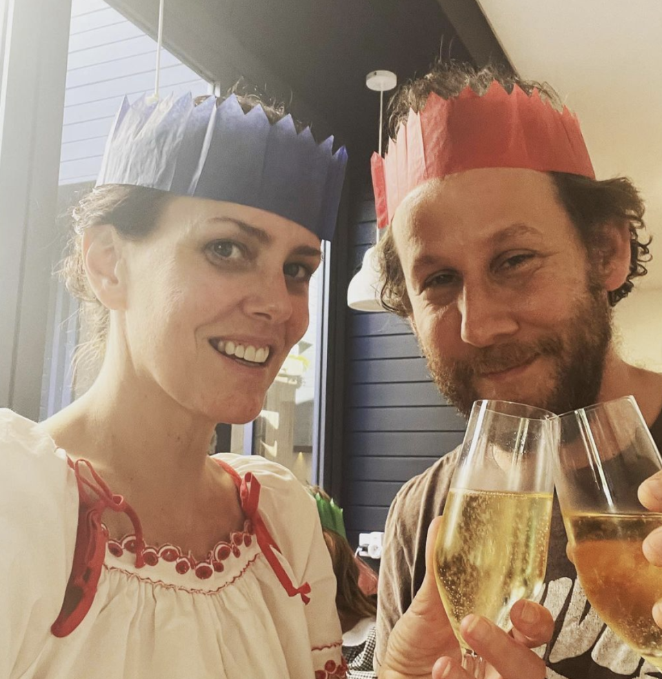 Ione Skye and her husband, musician Ben Lee wearing paper party crowns while enjoying Christmas Eve in Australia