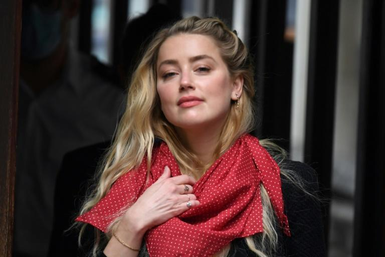 A spokeswoman for Amber Heard said she was was 'pleased -- but by no means surprised by the decision'