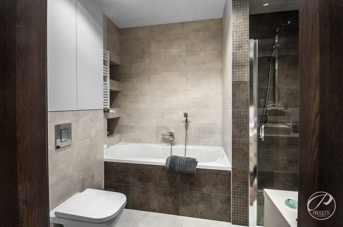 <p>Taking its cue from the downstairs spaces, this sleek bathroom knows all too well how to play with earthy hues and textured surfaces while making the most of its limited legroom.</p>  Credits: homify / Progetti Architektura