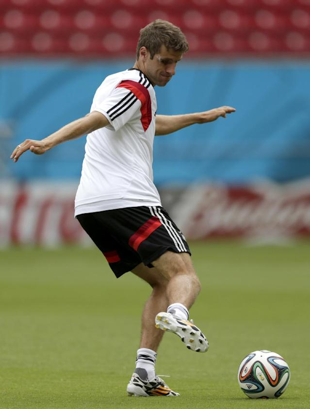 Germany's Thomas Mueller works out during a training session in Recife, Brazil, Wednesday, June 25, 2014. Germany will play the United States in group G of the 2014 soccer World Cup on June 26. (AP Photo/Julio Cortez)