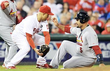 Pujols slides into third base safe during the seventh inning of Game 2