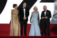 Britain's Prince Charles, from left, his wife Camilla the Duchess of Cornwall, Kate the Duchess of Cambridge and her husband Britain's Prince William pose for photographers upon arrival for the World premiere of the new film from the James Bond franchise 'No Time To Die', in London Tuesday, Sept. 28, 2021. (AP Photo/Matt Dunham)
