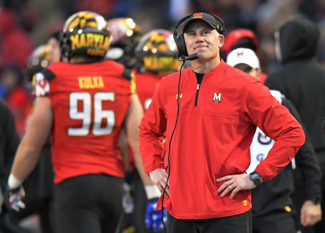 """Maryland coach D.J. Durkin looks at a replay as the <a class=""""link rapid-noclick-resp"""" href=""""/ncaaw/teams/maryland/"""" data-ylk=""""slk:Maryland Terrapins"""">Maryland Terrapins</a> play the <a class=""""link rapid-noclick-resp"""" href=""""/ncaaw/teams/michigan/"""" data-ylk=""""slk:Michigan Wolverines"""">Michigan Wolverines</a> on Nov. 11, 2017. (John McDonnell/Getty Images)"""