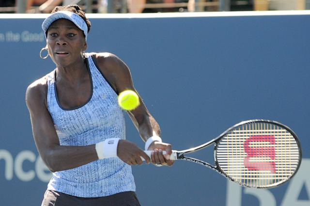 Venus Williams returns to Andrea Petkovic during Day 5 of the Bank of the West Classic at the Taube Family Tennis Stadium August 1, 2014 in Stanford, California (AFP Photo/Noah Graham)