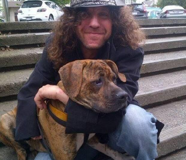 Bronx poses with his former owner Richard Bonora. The dog was seized from Bonora after a series of attacks and is now facing destruction. Bonora has since given up ownership of Bronx. (Facebook - image credit)