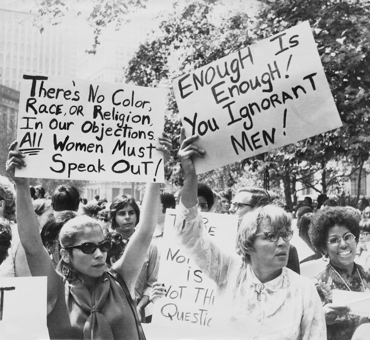 Women hold up signs demanding equal rights during a demonstration for women's liberation, New York City, circa 1968.