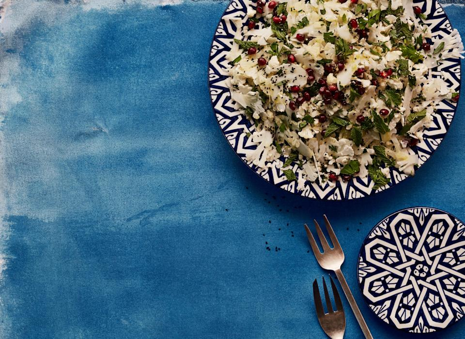 """Shave the cauliflower for this salad recipe within an hour of serving so that it won't have time to discolor, and make quick work of that task by using a mandoline. <a href=""""https://www.bonappetit.com/recipe/cauliflower-salad-with-mint-pomegranates-and-nigella-seeds?mbid=synd_yahoo_rss"""" rel=""""nofollow noopener"""" target=""""_blank"""" data-ylk=""""slk:See recipe."""" class=""""link rapid-noclick-resp"""">See recipe.</a>"""