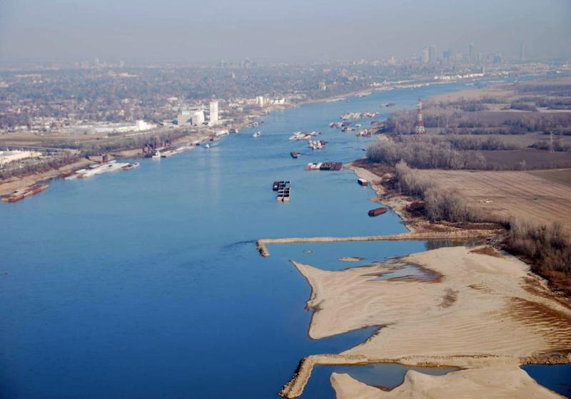 FILE - This Nov. 28, 2012 file photo provided by The United States Coast Guard shows man-made dikes, perpendicular to the shore,  and large sandbars exposed by low water levels along the shoreline of the Mississippi River South of St. Louis. Mayors from states along the Mississippi river said Thursday, March 21, 2013 that they would work with federal lawmakers to sharpen the national focus on the waterway after two years in which shipping has been threatened by flooding and then drought. (AP Photo/United States Coast Guard, Colby Buchanan, File)