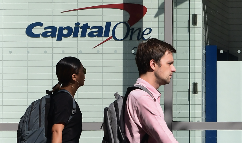 Pedestrians walk past a branch of a Capital One bank, with cafe and ATM, in Los Angeles. California on July 30, 2019. (Photo: Frederic J. BROWN / AFP)