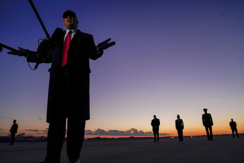President Donald Trump speaks to reporters as he arrives at Charlotte Douglas International Airport in Charlotte, N.C., to head to a campaign rally at Hickory Regional Airport, Sunday, Nov. 1, 2020. (AP Photo/Evan Vucci)