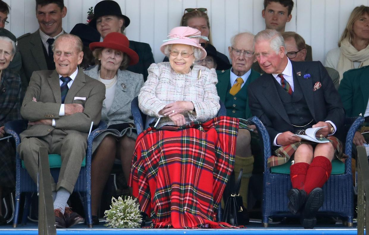 BRAEMAR, SCOTLAND - SEPTEMBER 02:  Queen Elizabeth II, Prince Philip, Duke of Edinburgh and Prince Charles, Prince of Wales watch the 2017 Braemar Gathering at The Princess Royal and Duke of Fife Memorial Park on September 2, 2017 in Braemar, Scotland.  (Photo by Chris Jackson/Getty Images)
