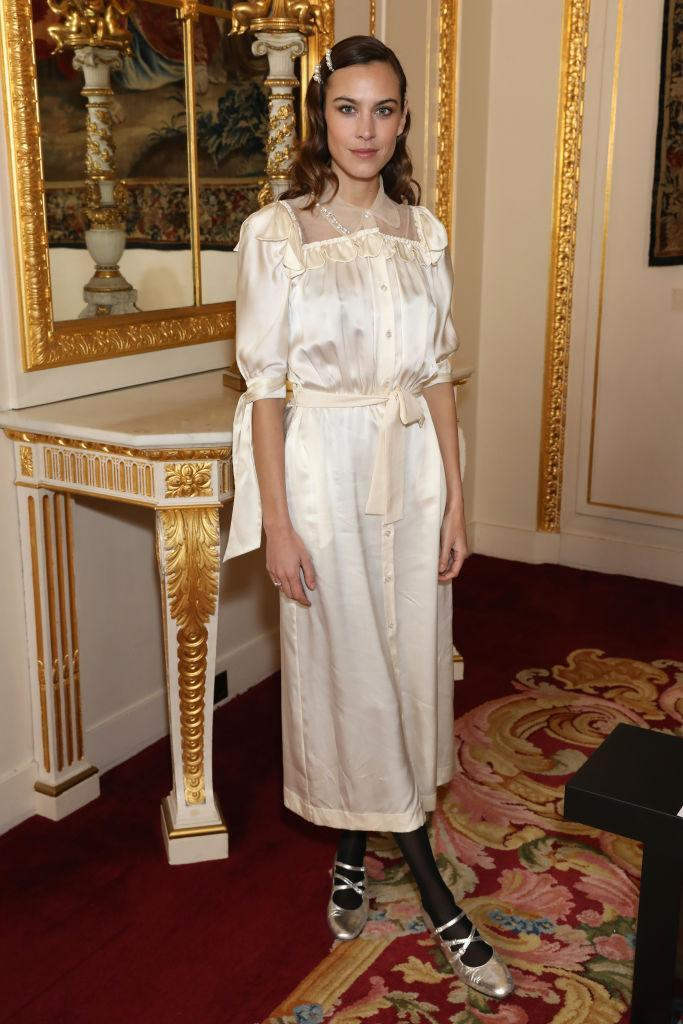 <p>Alexa Chung is Simone Rocha's go-to muse and for good reason, as the model donned a silky number with pearl-embroidered hair grips. <em>[Photo: Getty]</em> </p>