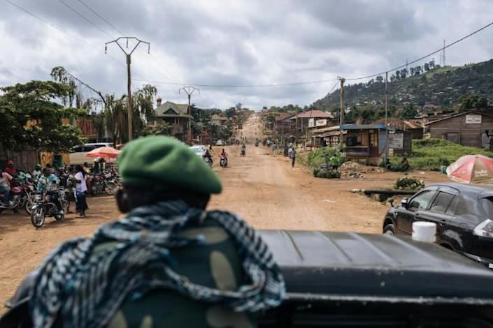 Congolese troops patrolling the highway from Beni to the Ugandan border. The road and its surrounding villages have suffered several dozen ADF attacks since last December
