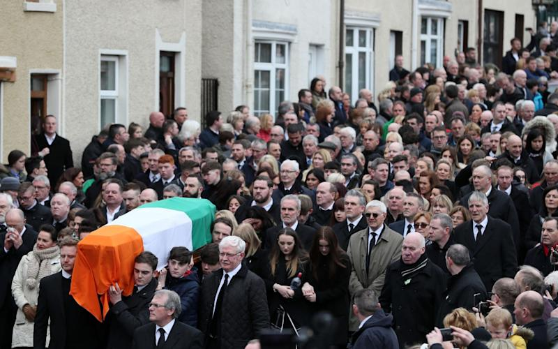 The coffin of Northern Ireland's former deputy first minister and ex-IRA commander Martin McGuinness is carried up Barrack Street - PA