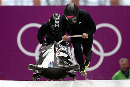Pilot Elana Meyers (R) of the U.S. starts in a two-women bobsleigh training session at the Sanki Sliding Center in Rosa Khutor, during the Sochi 2014 Winter Olympics February 15, 2014. REUTERS/Murad Sezer