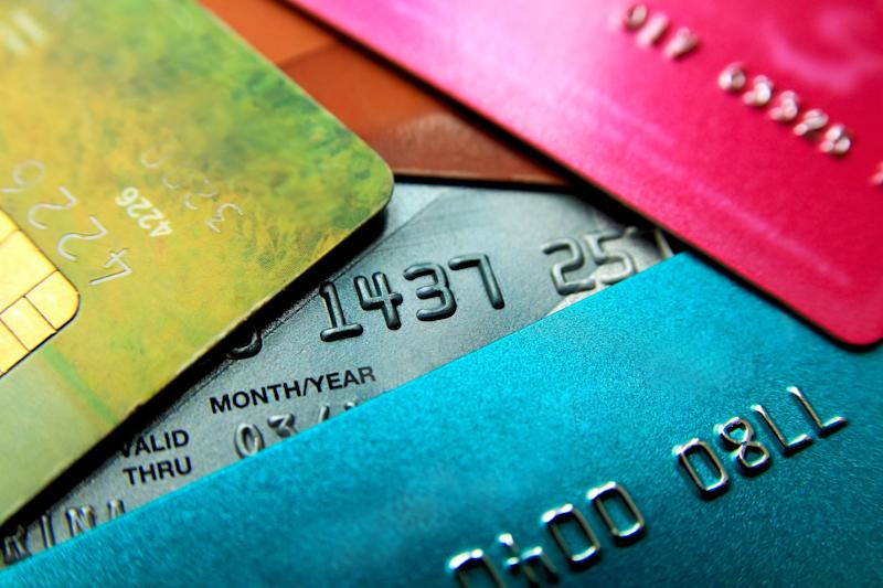 Pile of multi-colored credit cards.