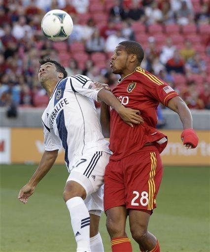 Los Angeles Galaxy forward Charlie Rugg, left, battles with Real Salt Lake defender Chris Schuler (28) during the first half of an MLS soccer game Saturday, April 27, 2013, Sandy, Utah. (AP Photo/Rick Bowmer)